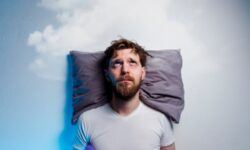 Man having problems/ insomnia, laying in bed